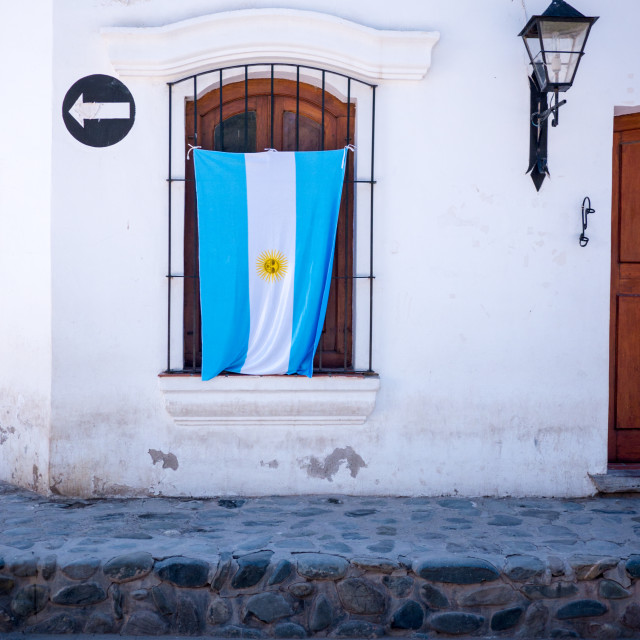 """""""Argentinian Flag Hanging On Patriotic House in Small South Ameri"""" stock image"""