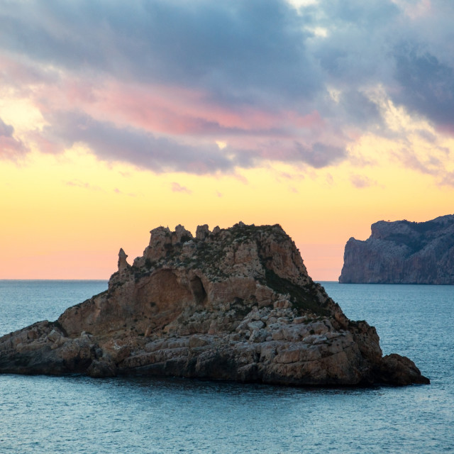 """Winter sunset at Es Malgrat islands Mallorca in February."" stock image"
