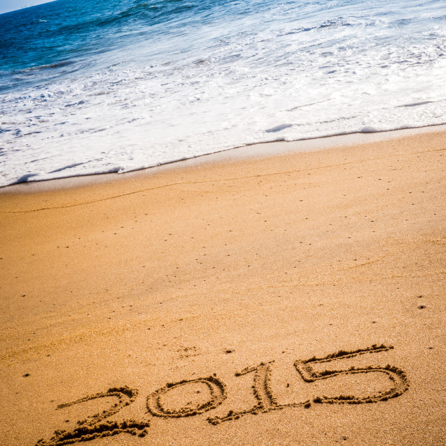 """""""2015 written into the sand on a beach"""" stock image"""