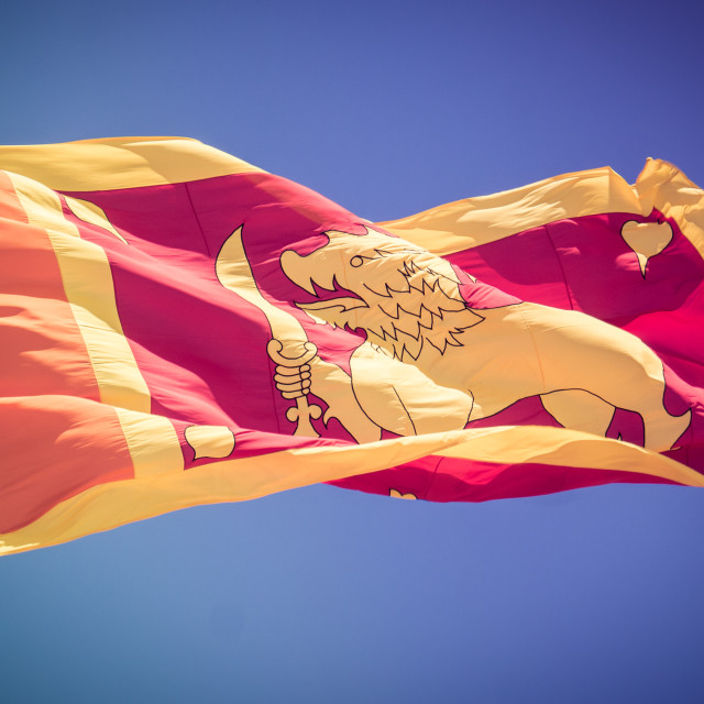 """Sri Lankan flag billows in the wind"" stock image"