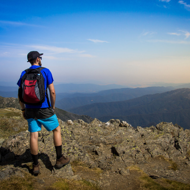 """""""Male Hiker looking out over mountains"""" stock image"""