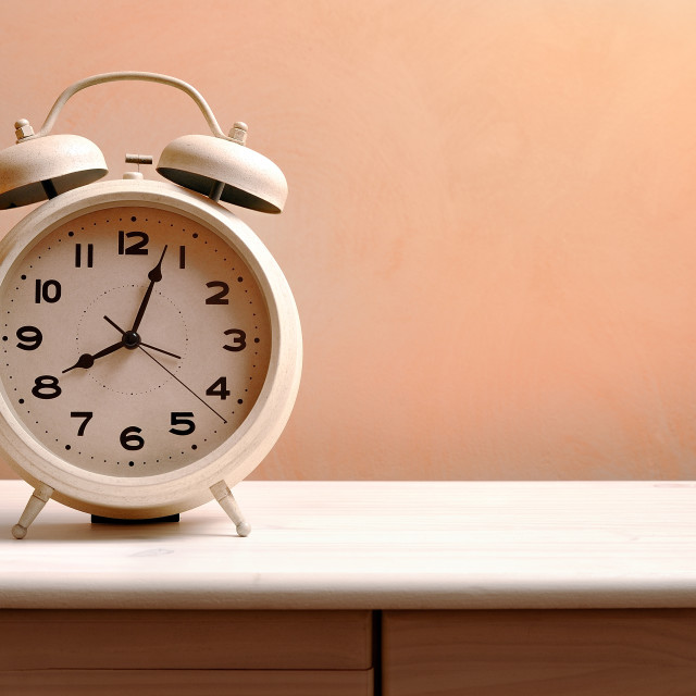 """vintage alarm clock on a table"" stock image"
