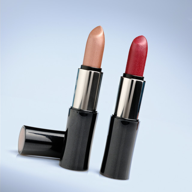 """two red and cream lipsticks"" stock image"