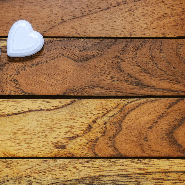 """Two hearts with wooden background"" stock image"