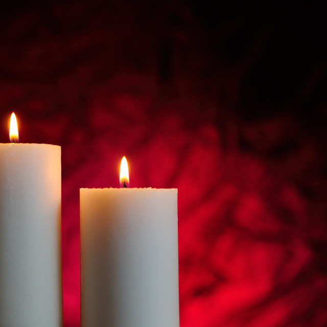"""two candles with red background"" stock image"