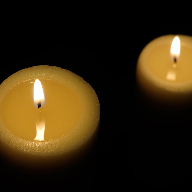 """two candles with dark background top view"" stock image"