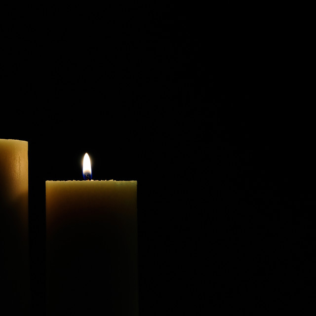 """two candles with dark background"" stock image"