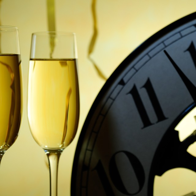 """two glasses and a clock ready for a new year"" stock image"