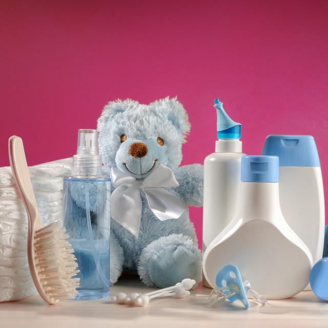 """toiletries baby with diapers and pacifiers"" stock image"