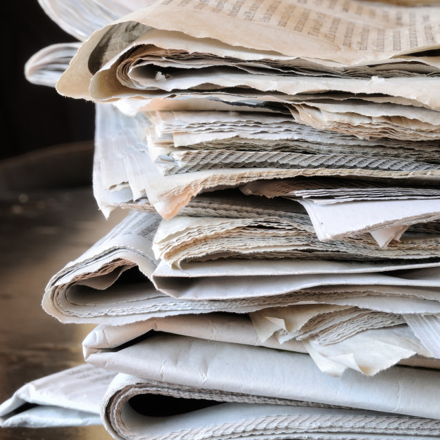 """stack of newspapers on table"" stock image"