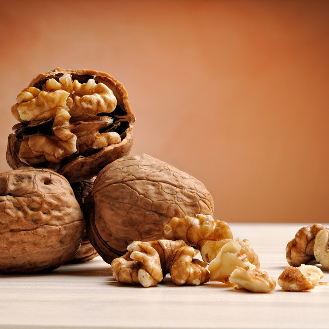 """group of walnuts on a table with brown background"" stock image"