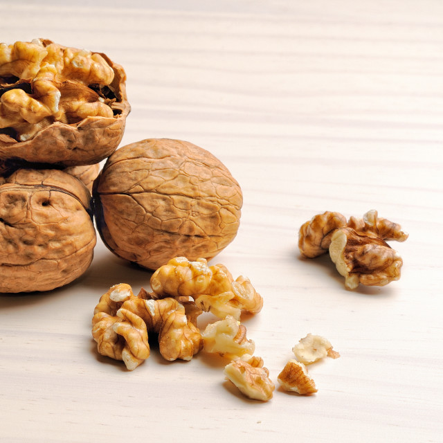 """group of walnuts on a table"" stock image"