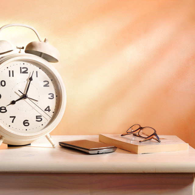 """bedside alarm clock and personal belongings"" stock image"