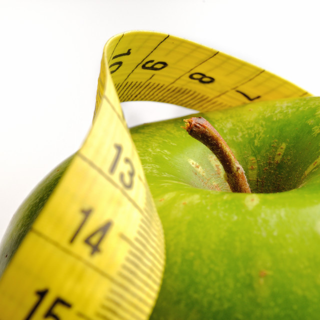 """apple and measuring tape for a healthy lifestyle 1"" stock image"
