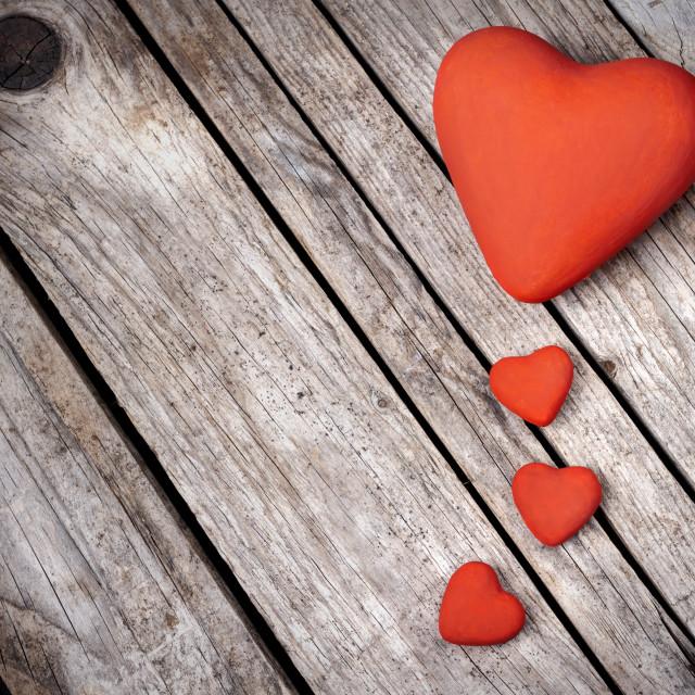"""Hearts on wood background"" stock image"
