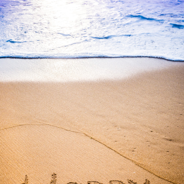 """The word WORRY written in the sand"" stock image"