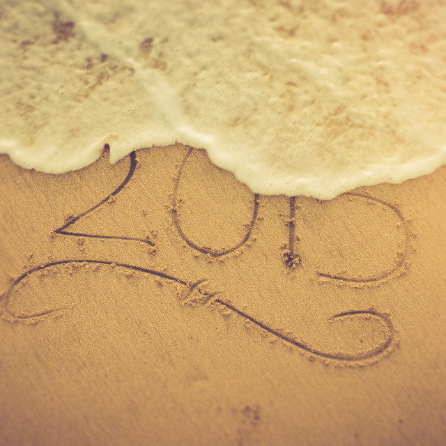 """2015 written into the sand on a beach"" stock image"