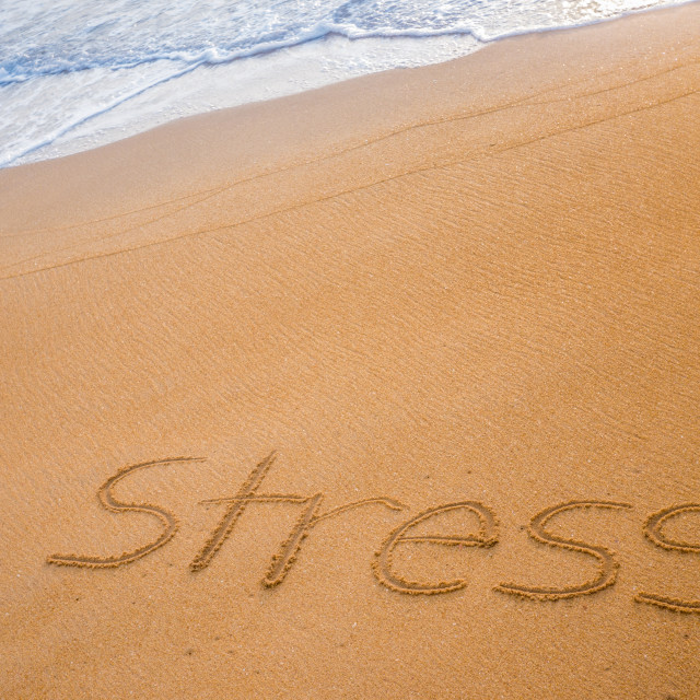 """The word STRESS written in the sand"" stock image"