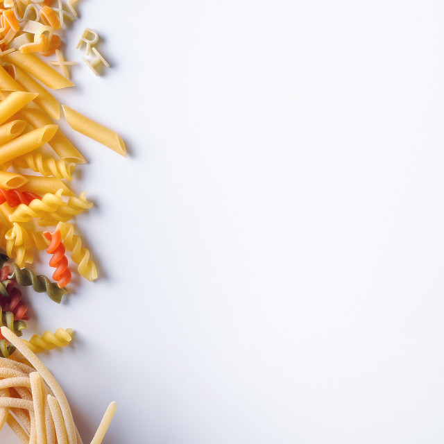 """various types of pasta left isolated"" stock image"