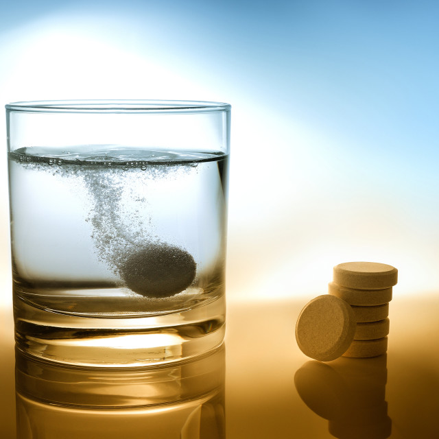 """Glass of water with effervescent tablet"" stock image"