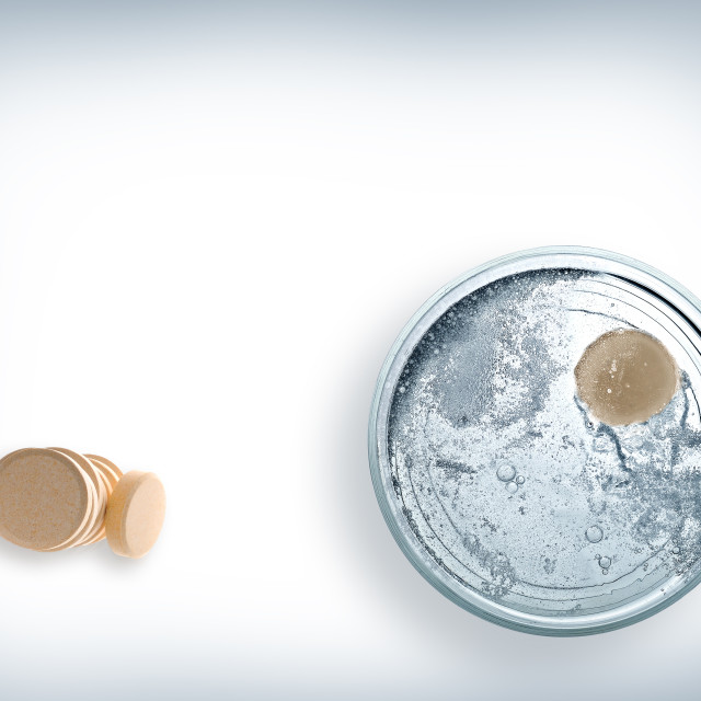 """Glass of water with effervescent tablet top view"" stock image"