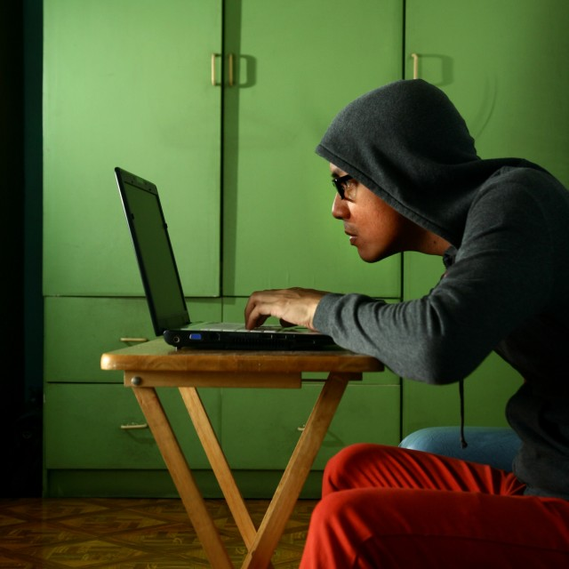 """""""Man working on a laptop computer"""" stock image"""