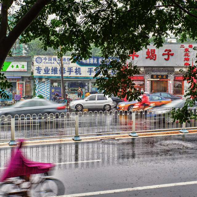"""""""Cycling in the rain"""" stock image"""