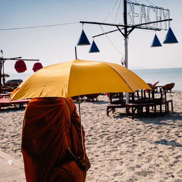 """Monk under the umbrella"" stock image"