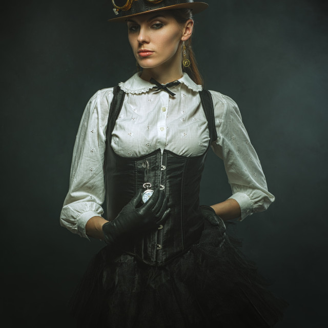 """Elegant steampunk girl with the clock"" stock image"