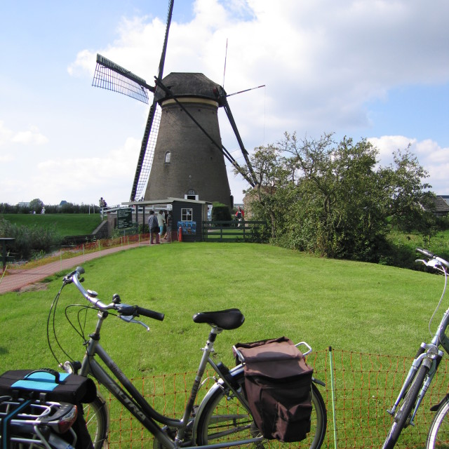 """Typical Dutch windmill with bikes"" stock image"
