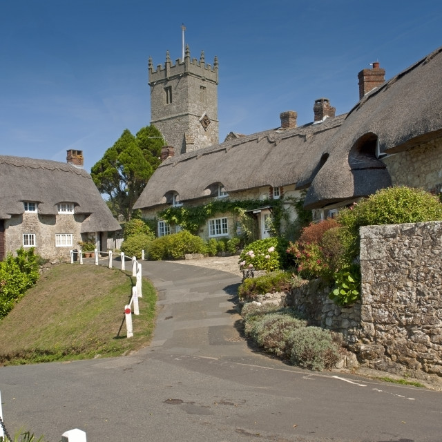 """""""Thatched cottages and the tower of All Saints' church in Godshill, Isle of Wight"""" stock image"""