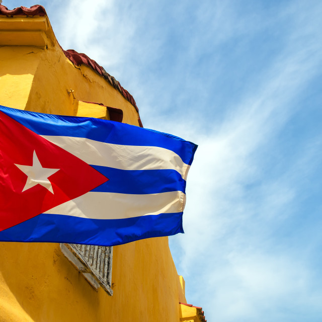 """Cuban Flag and Colonial Buildings"" stock image"