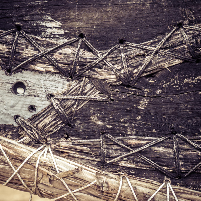 """Old Fishing Boat Tied Together With Rope"" stock image"