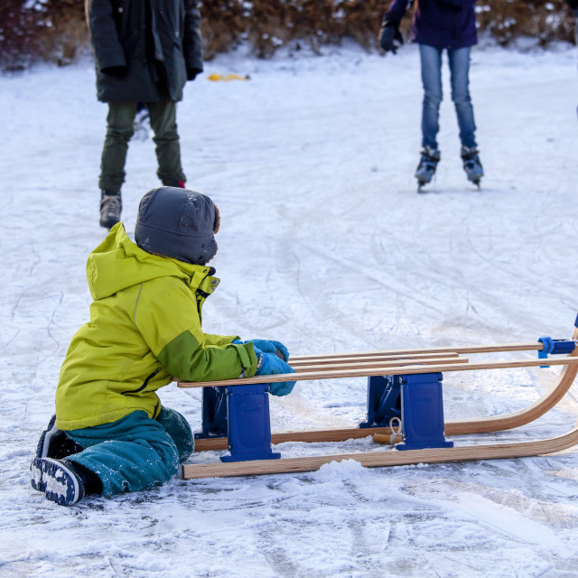 """""""Boy with sleigh"""" stock image"""