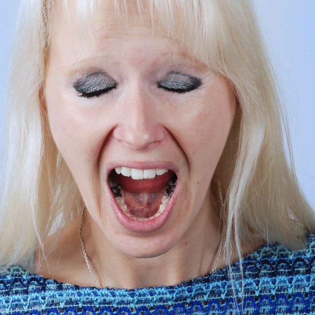 """""""Young blond woman with a cry"""" stock image"""