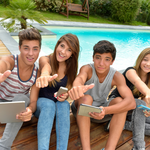 """""""Young teenagers playing on tablet and phone"""" stock image"""
