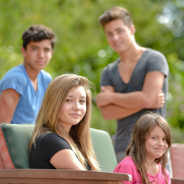 """""""Group of teenagers on a swimming pool terrace"""" stock image"""