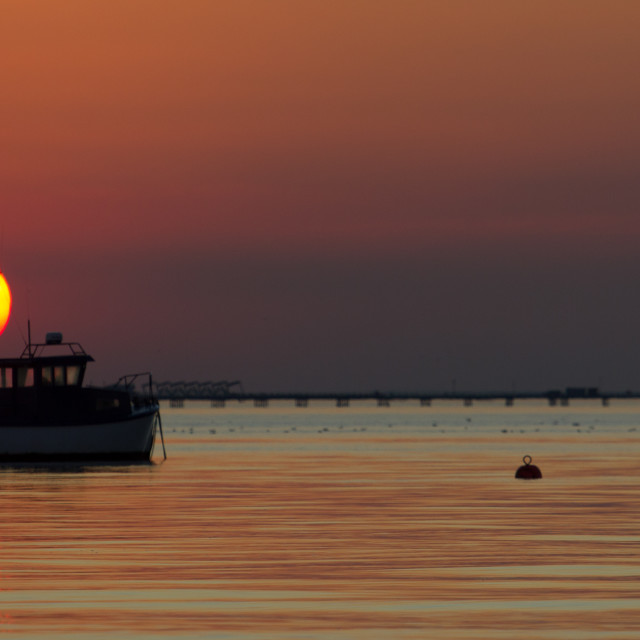 """""""Boat at sunset"""" stock image"""
