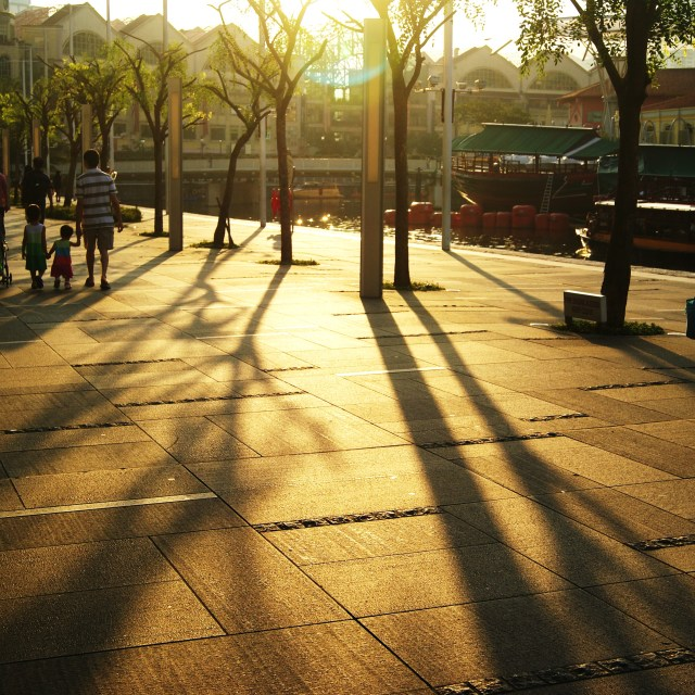 """Sunset in Clarke Quay, Singapore"" stock image"