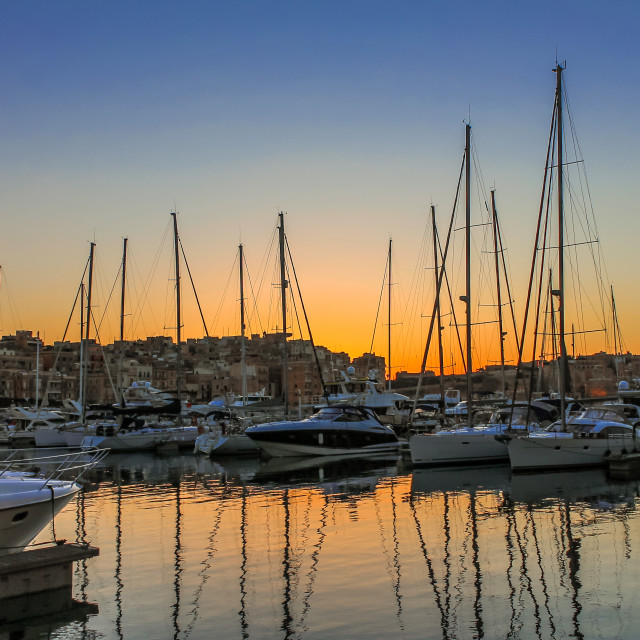 """Sunset behind boats"" stock image"