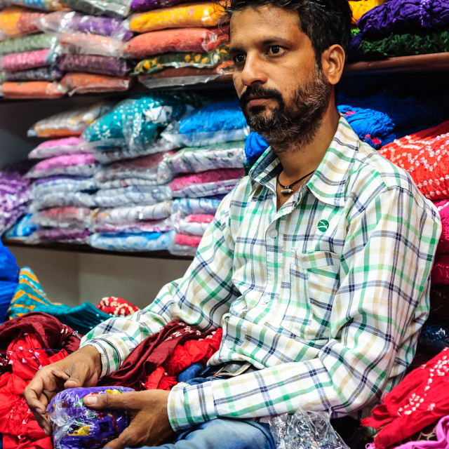 """Garment seller at the sales counter"" stock image"