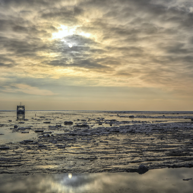 """Sunset on a wadden sea with ice"" stock image"
