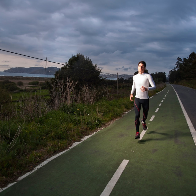 """Runner man in the road"" stock image"