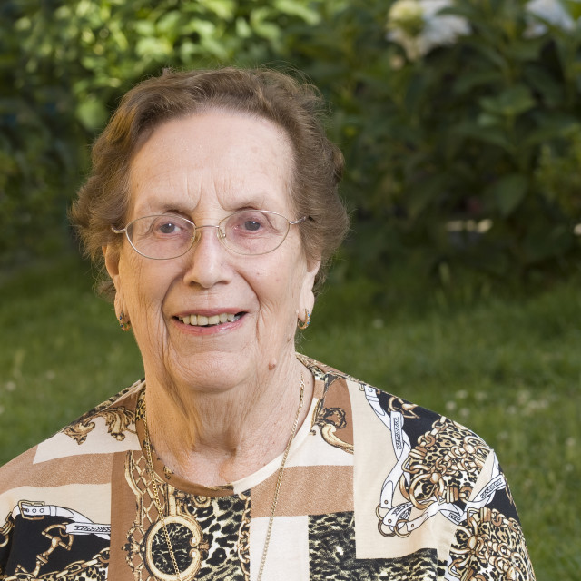 """""""Elderly woman with glasses and toothed smile"""" stock image"""