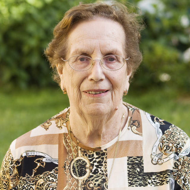 """""""Elderly woman with glasses and smile in her face"""" stock image"""