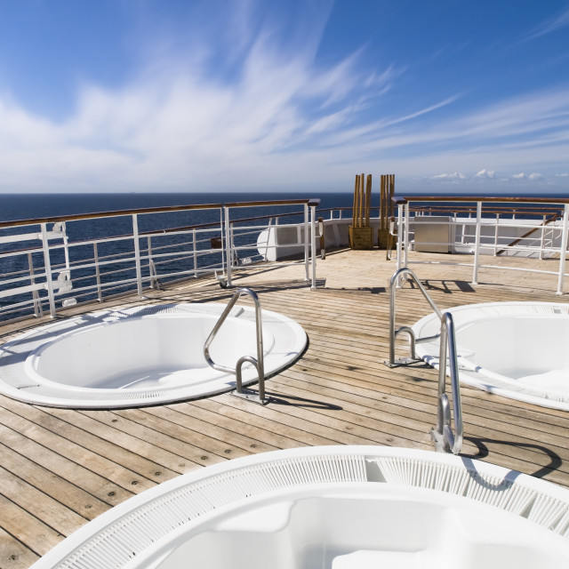 """""""Three hot tub on the deck of a cruise"""" stock image"""