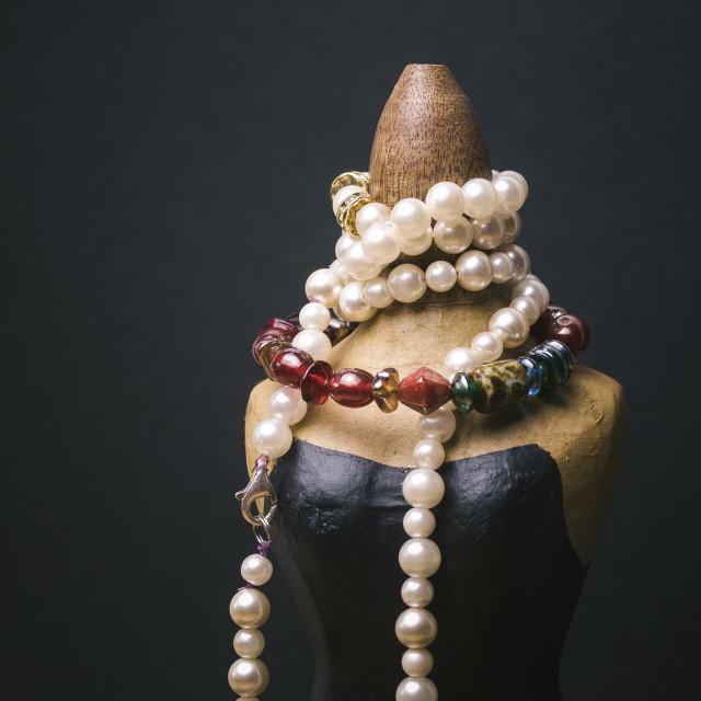 """""""Miniature mannequin with necklaces"""" stock image"""