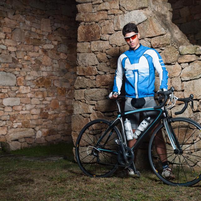 """Cyclist posing with his racing bike"" stock image"