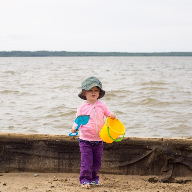 """Toddler on the beach"" stock image"