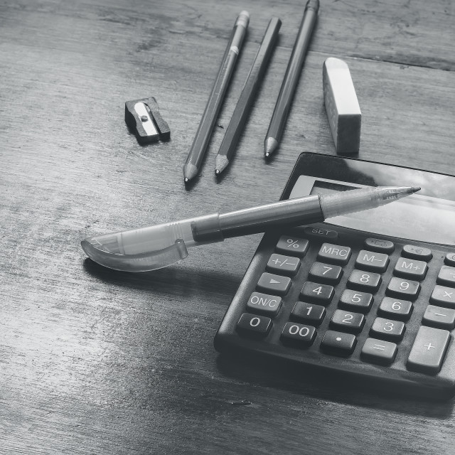 """calculator and pencil on a table"" stock image"